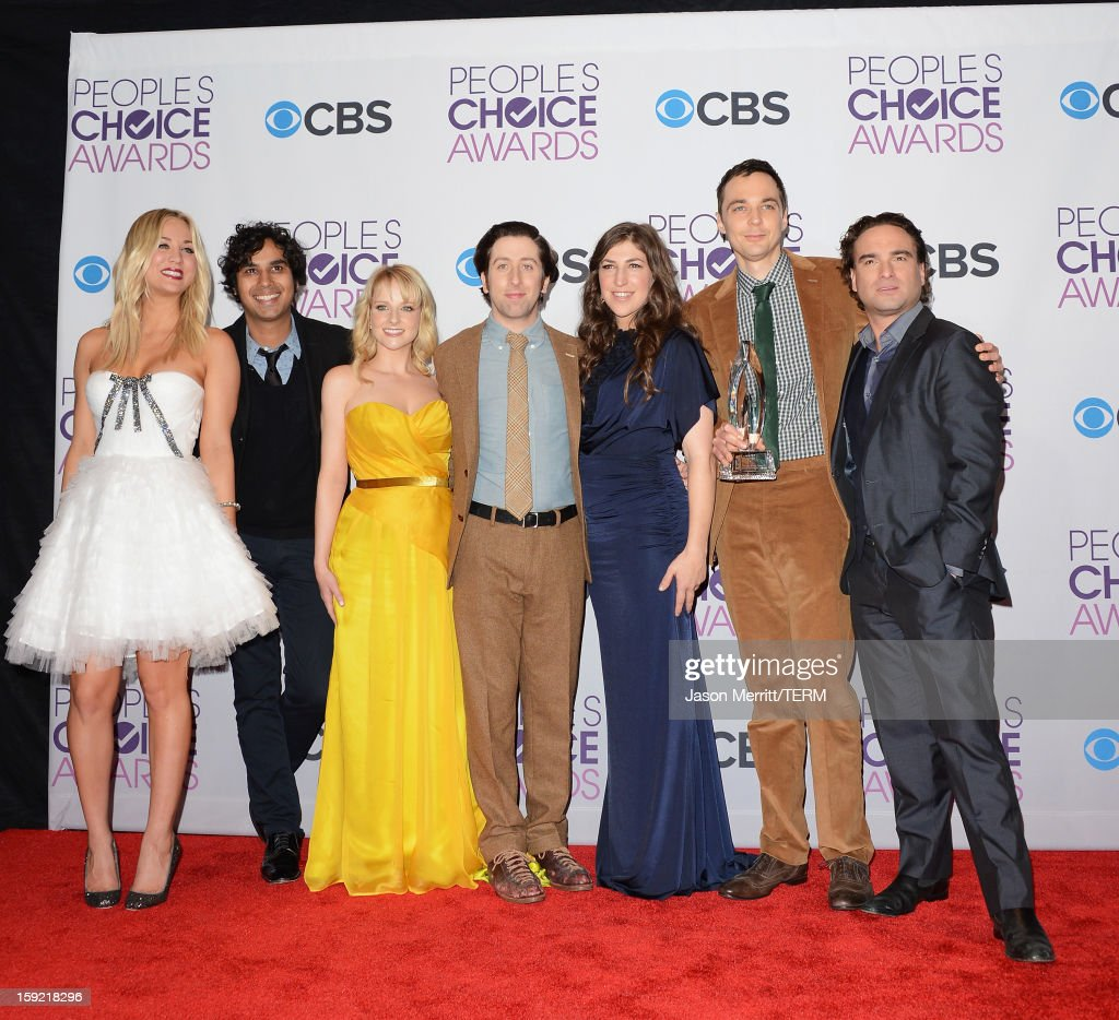 Actors (L-R) Kaley Cuoco, Kunal Nayyar, Melissa Rauch, Simon Helberg, Mayim Bialik, Jim Parsons, and Johnny Galecki of Favorite Network TV Comedy winner 'The Big Bang Theory' pose in the press room at the 39th Annual People's Choice Awards at Nokia Theatre L.A. Live on January 9, 2013 in Los Angeles, California.