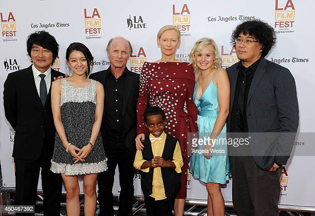 Actors Kangho Song Ahsung Ko Ed Harris Tilda Swinton Marcanthonee Reis Alison Pill and director Joonho Bong attend the opening night premiere of...