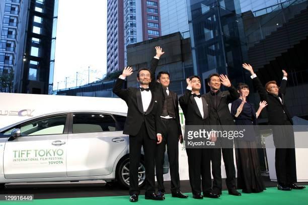 Actors Kanji Furutachi Shun Oguri director Shuichi Okita actor Koji Yakusho and actress Asami Usuda wave during the 24th Tokyo International Film...