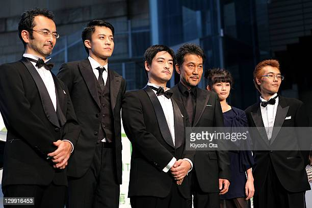 Actors Kanji Furutachi Shun Oguri director Shuichi Okita actor Koji Yakusho and actress Asami Usuda attend the 24th Tokyo International Film Festival...