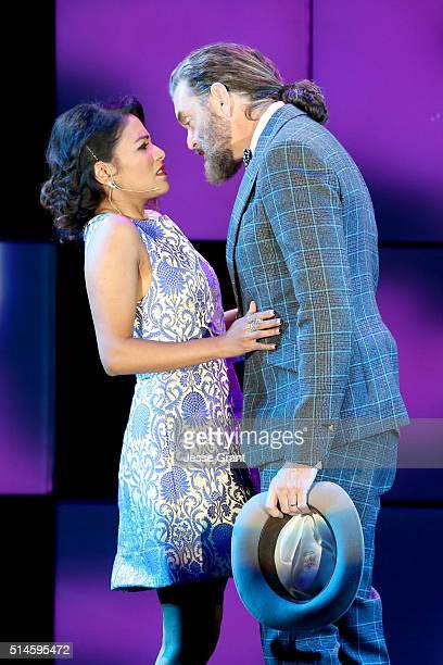 Actors Karen David and Timothy Omundson perform onstage during the 24th and final 'A Night at Sardi's' to benefit the Alzheimer's Association at The...
