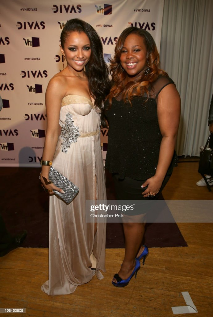 Actors Kat Graham and <a gi-track='captionPersonalityLinkClicked' href=/galleries/search?phrase=Amber+Riley&family=editorial&specificpeople=5662111 ng-click='$event.stopPropagation()'>Amber Riley</a> attend 'VH1 Divas' 2012 at The Shrine Auditorium on December 16, 2012 in Los Angeles, California.