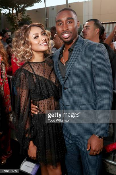 Actors Kat Graham and Demetrius Shipp Jr at the 'ALL EYEZ ON ME' Premiere at Westwood Village Theatre on June 14 2017 in Westwood California