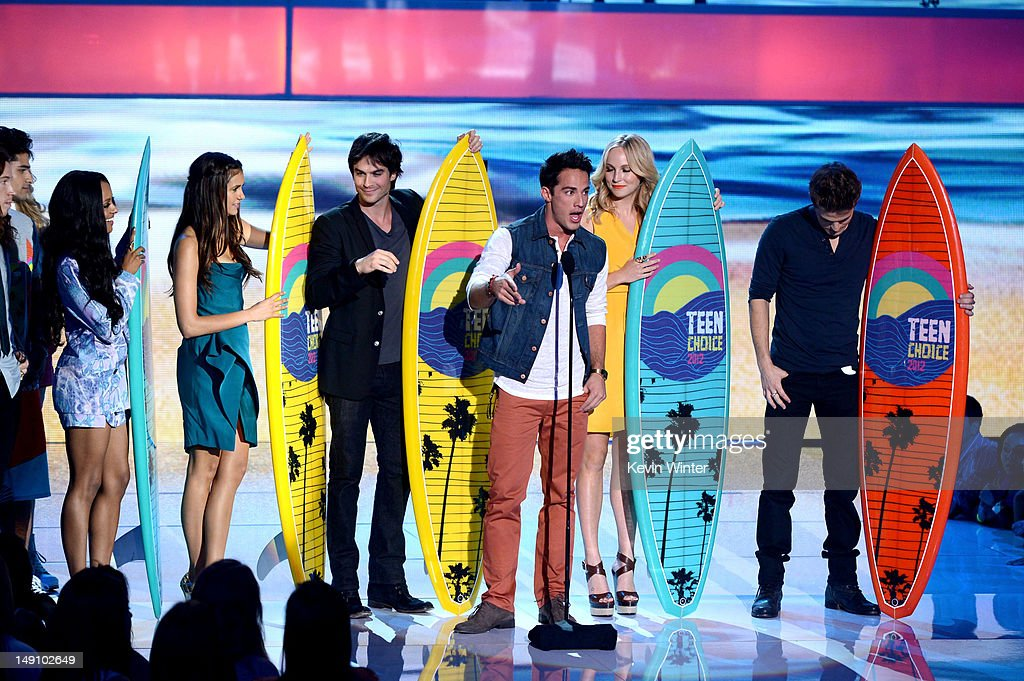 Actors Kat Graham, Nina Dobrev, Ian Somerhalder, Michael Trevino, Candice Accola and Paul Wesley accept the Choice Fantasy/Sci-Fi Show award onstage during the 2012 Teen Choice Awards at Gibson Amphitheatre on July 22, 2012 in Universal City, California.