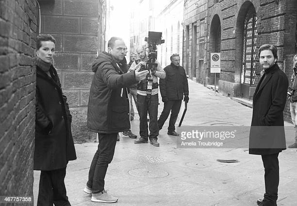 Actors Kate Beckinsale and Daniel Bruhl on set with film director by Michael Winterbottom during the making of Face of an Angel Photographed on...