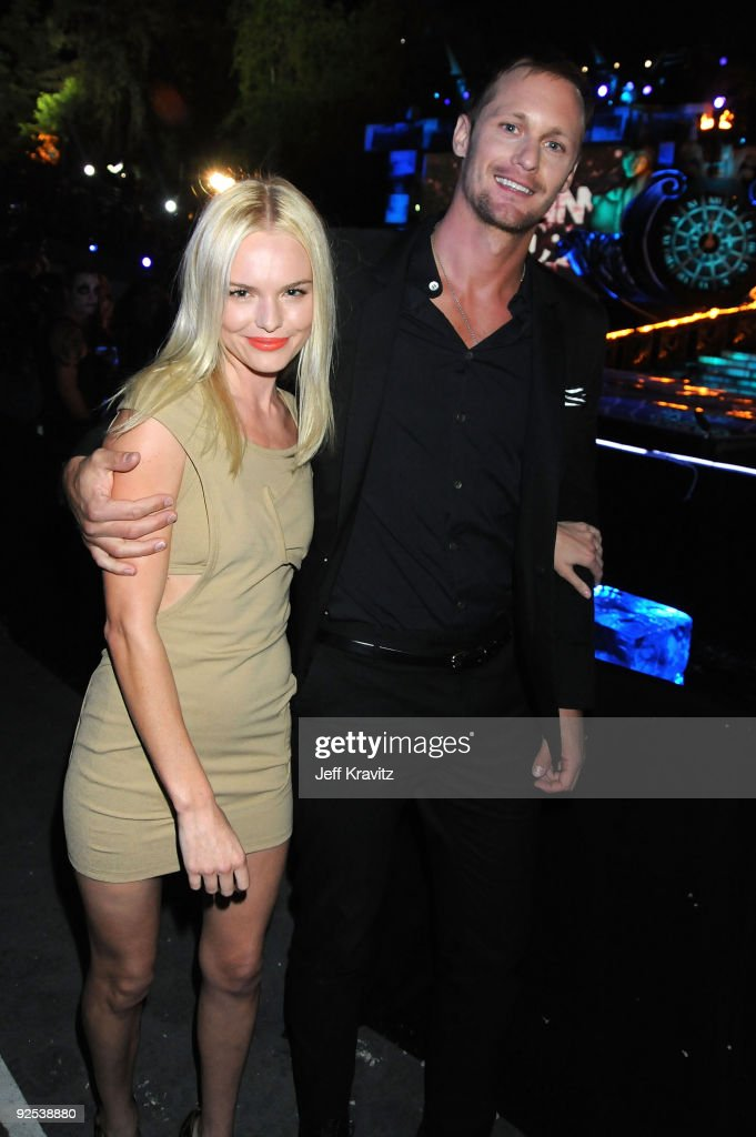 Actors Kate Bosworth (L) and Alexander Skarsgard onstage during Spike TV's Scream 2009 held at the Greek Theatre on October 17, 2009 in Los Angeles, California.