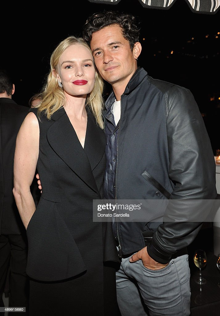 Actors Kate Bosworth (L) and Orlando Bloom attend a cocktail event hosted by Dior Homme's Kris Van Assche at Chateau Marmont on September 24, 2015 in Los Angeles, California.