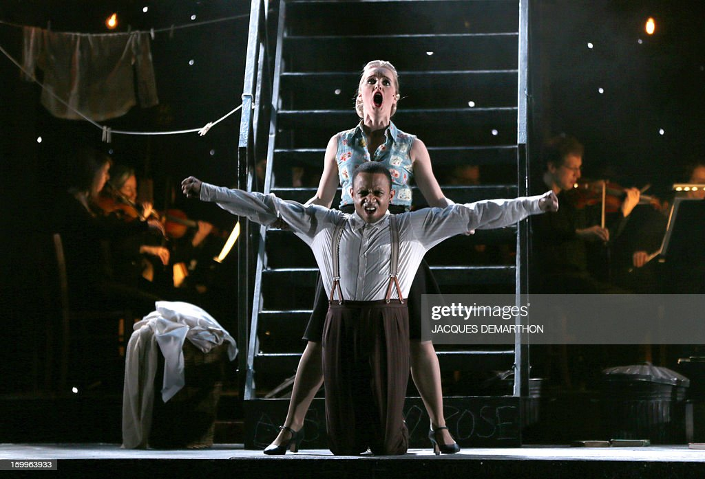 Actors Kate Nelson (Top) who plays Mae Jones, and Ashley Campbell, who plays Dick McGann, perform during a rehearsal of the opera 'Street scene' written by German composer Kurt Weill, directed by English artistic director John Fulljames, at the Theatre du Chatelet, on January 23, 2012 in Paris.