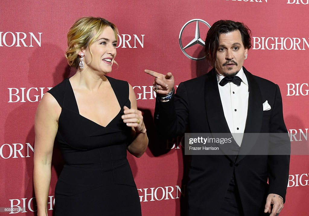 Actors Kate Winslet and Johnny Depp attend the 27th Annual Palm Springs International Film Festival Awards Gala at Palm Springs Convention Center on...