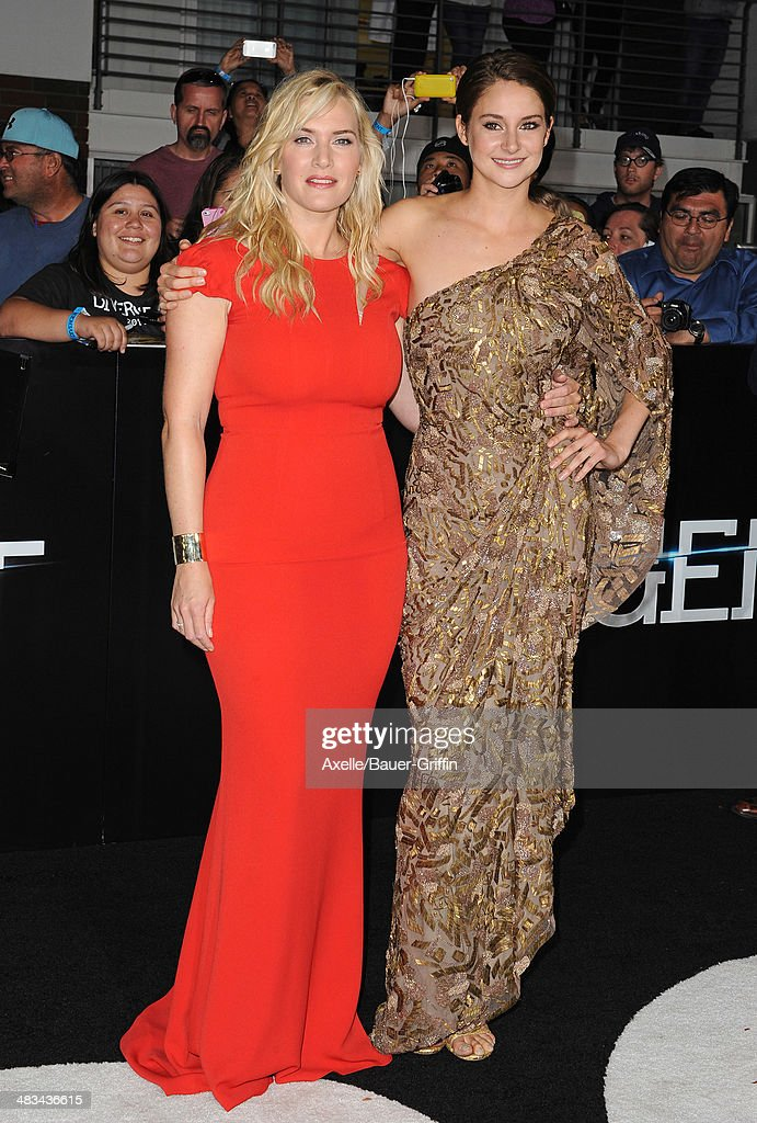 Actors <a gi-track='captionPersonalityLinkClicked' href=/galleries/search?phrase=Kate+Winslet&family=editorial&specificpeople=201923 ng-click='$event.stopPropagation()'>Kate Winslet</a> and <a gi-track='captionPersonalityLinkClicked' href=/galleries/search?phrase=Shailene+Woodley&family=editorial&specificpeople=676833 ng-click='$event.stopPropagation()'>Shailene Woodley</a> arrive at the Los Angeles Premiere of 'Divergent' at Regency Bruin Theatre on March 18, 2014 in Los Angeles, California.