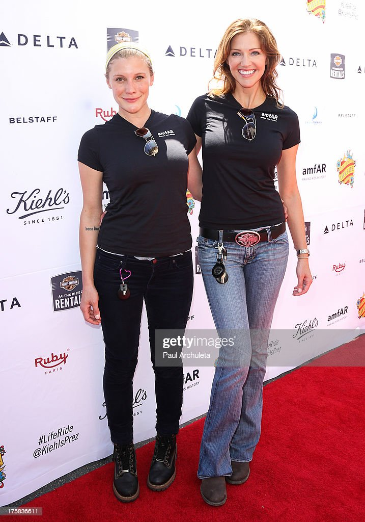 Actors Katee Sackhoff (L) and Tricia Helfer (R) attend the 4th annual Kiehl's LifeRide for amfAR at The Grove on August 8, 2013 in Los Angeles, California.