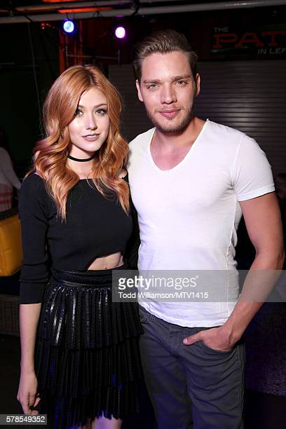 Actors Katherine McNamara and Dominic Sherwood pose backstage at the MTV Fandom Awards San Diego at PETCO Park on July 21 2016 in San Diego California