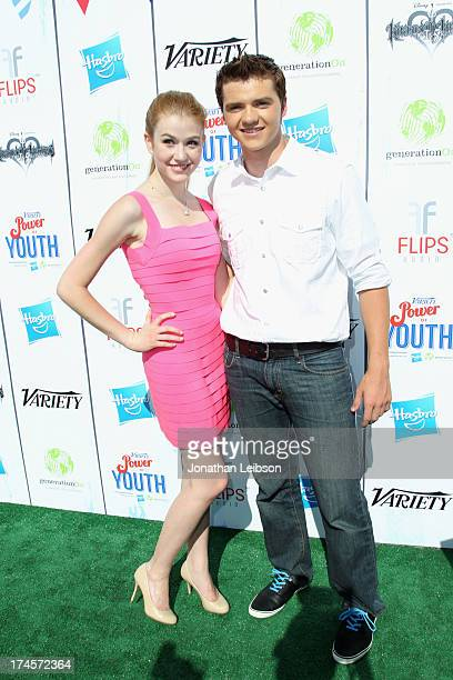 Actors Katherine McNamara and Joel Courtney attend Variety's Power of Youth presented by Hasbro Inc and generationOn at Universal Studios Backlot on...