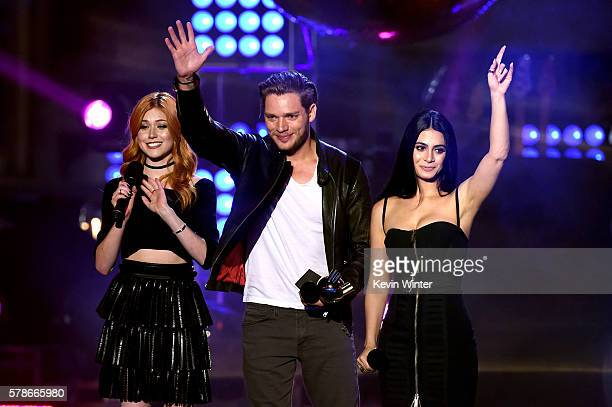 Actors Katherine McNamara Dominic Sherwood and Emeraude Toubia accept the Best New Fandom of the Year award onstage at the MTV Fandom Awards San...