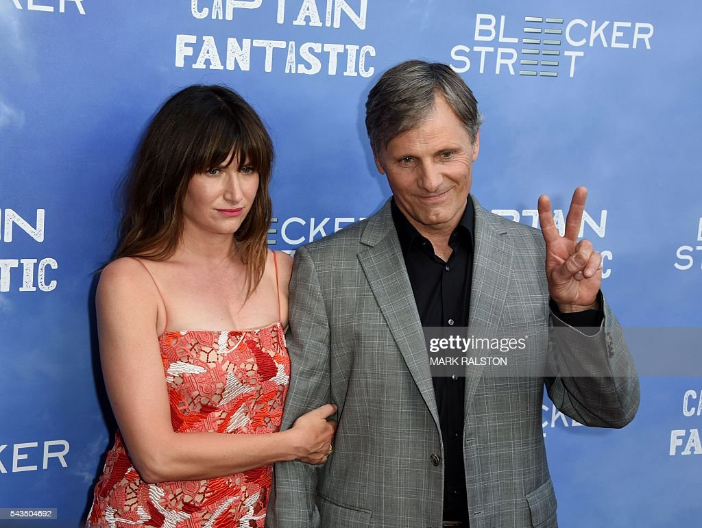 Actors Kathryn Hahn (L) and Viggo Mortensen arrive for the premiere of 'Captain Fantastic' at the Harmony Gold in Los Angeles, California on June 28, 2016. / AFP / Mark Ralston