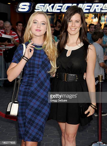 Actors Kathryn Newton and Katie Featherston arrive at the Los Angeles premiere of 'Insidious Chapter 2' at Universal CityWalk on September 10 2013 in...