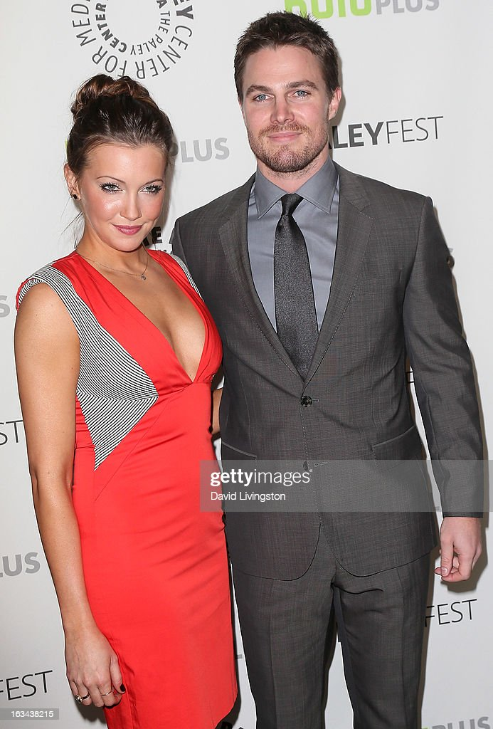 Actors <a gi-track='captionPersonalityLinkClicked' href=/galleries/search?phrase=Katie+Cassidy&family=editorial&specificpeople=569891 ng-click='$event.stopPropagation()'>Katie Cassidy</a> (L) and <a gi-track='captionPersonalityLinkClicked' href=/galleries/search?phrase=Stephen+Amell&family=editorial&specificpeople=4500297 ng-click='$event.stopPropagation()'>Stephen Amell</a> attend The Paley Center For Media's PaleyFest 2013 honoring 'Arrow' at the Saban Theatre on March 9, 2013 in Beverly Hills, California.