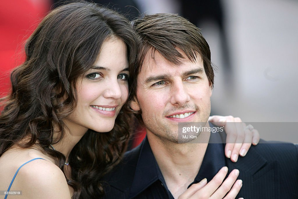 Actors <a gi-track='captionPersonalityLinkClicked' href=/galleries/search?phrase=Katie+Holmes&family=editorial&specificpeople=201598 ng-click='$event.stopPropagation()'>Katie Holmes</a> and fiance <a gi-track='captionPersonalityLinkClicked' href=/galleries/search?phrase=Tom+Cruise&family=editorial&specificpeople=156405 ng-click='$event.stopPropagation()'>Tom Cruise</a> arrive at the UK premiere of 'War Of The Worlds' at the Odeon Leicester Square June 19, 2005 in London, England.