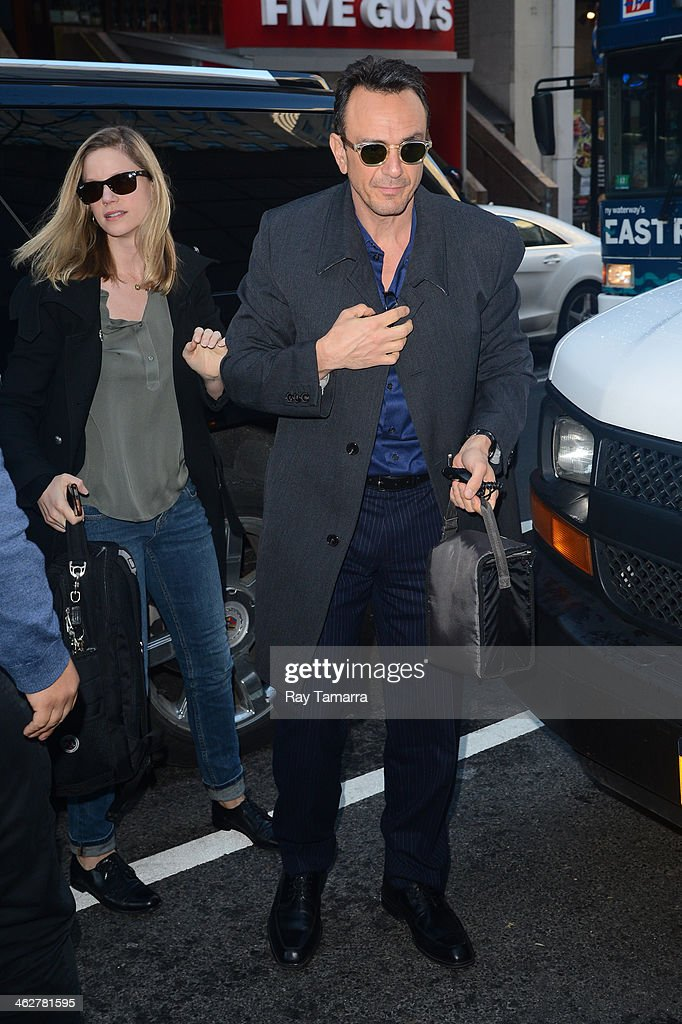 Actors Katie Wright (L) and Hank Azaria enters the 'Today Show' taping at the NBC Rockefeller Center Studios on January 15, 2014 in New York City.