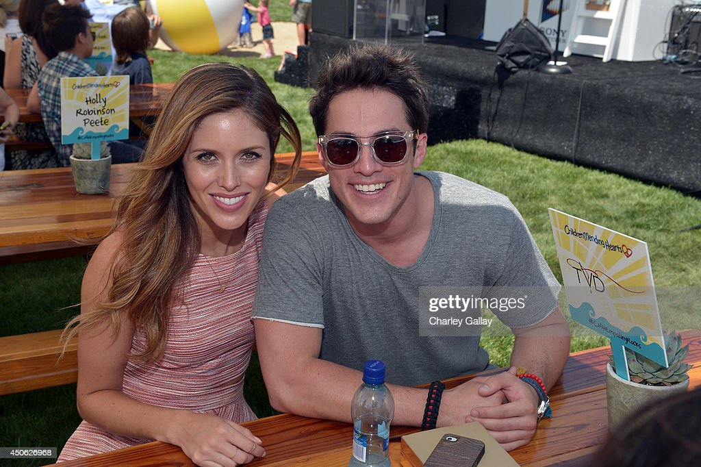 Actors <a gi-track='captionPersonalityLinkClicked' href=/galleries/search?phrase=Kayla+Ewell&family=editorial&specificpeople=225010 ng-click='$event.stopPropagation()'>Kayla Ewell</a> and <a gi-track='captionPersonalityLinkClicked' href=/galleries/search?phrase=Michael+Trevino&family=editorial&specificpeople=4069456 ng-click='$event.stopPropagation()'>Michael Trevino</a> attend the Children Mending Hearts 6th Annual Fundraiser 'Empathy Rocks: A Spring Into Summer Bash' at a private residence on June 14, 2014 in Beverly Hills, California.