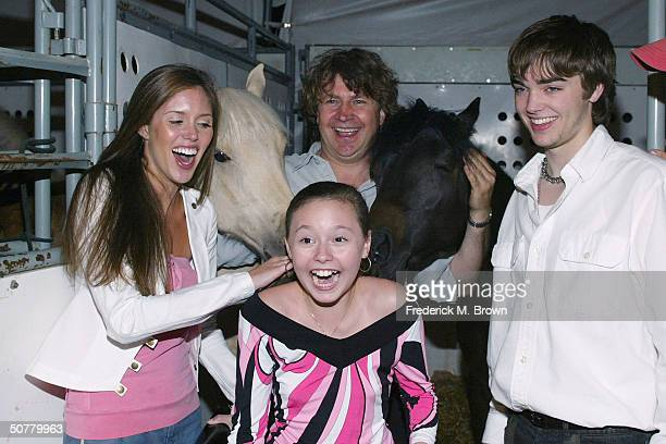 Actors Kayla Ewell Jillian Clare reacts after horse bites hair Normand Latourelle president and artistic director of 'Cavalia' and actor Drew Tyler...