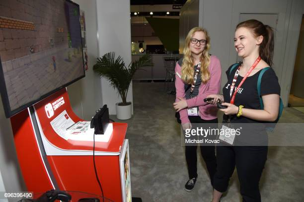 Actors Kayla McCormick and Sierra McCormick play Super Mario Odyssey at the Nintendo booth at the 2017 E3 Gaming Convention at Los Angeles Convention...