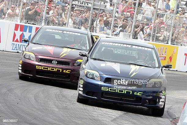 Actors Keanu Reeves and Christian Slater race at the Toyota Grand Prix Pro / Celebrity Race Day on April 17 2010 in Long Beach California