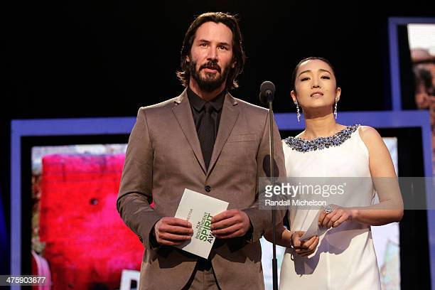 Actors Keanu Reeves and Gong Li onstage during the 2014 Film Independent Spirit Awards at Santa Monica Beach on March 1 2014 in Santa Monica...