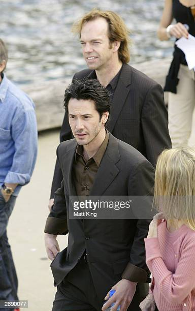 Actors Keanu Reeves and Hugo Weaving arrive at a press conference for the Australian premiere of the movie 'The Matrix Revolutions' November 2 2003...