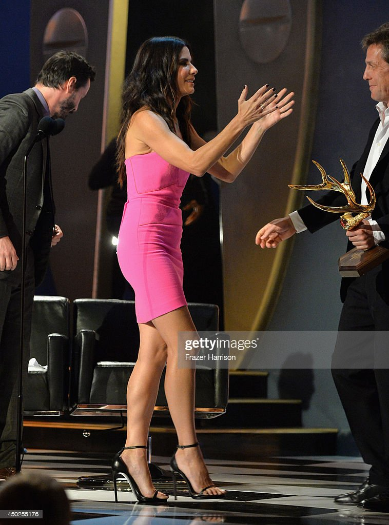 Actors Keanu Reeves, Sandra Bullock and Hugh Grant speak onstage during Spike TV's 'Guys Choice 2014' at Sony Pictures Studios on June 7, 2014 in Culver City, California.