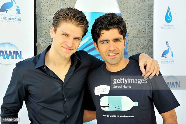 Actors Keegan Allen and Adrian Grenier attend the World Animal Day Celebration at International Bird Rescue on October 2 2014 in Fairfield California