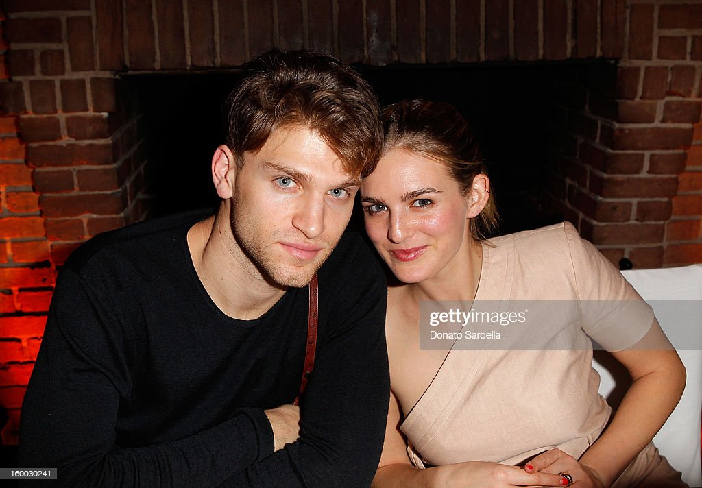 Actors Keegan Allen (L) and Nathalie Love attend the Ferragamo presentation Spring Summer Runway Collection with VIP dinner, hosted by Jacqui Getty and Harpers BAZAAR at Chateau Marmont on January 24, 2013 in Los Angeles, California.