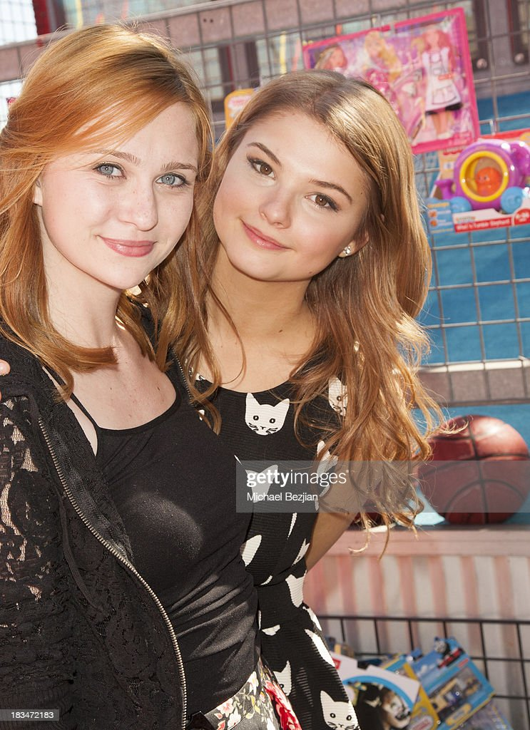 Actors Keely Marshall and <a gi-track='captionPersonalityLinkClicked' href=/galleries/search?phrase=Stefanie+Scott&family=editorial&specificpeople=5781540 ng-click='$event.stopPropagation()'>Stefanie Scott</a> volunteer at the 14th Annual 'Mattel Party On The Pier' Benefiting Mattel Children's Hospital UCLA at Santa Monica Pier on October 6, 2013 in Santa Monica, California.