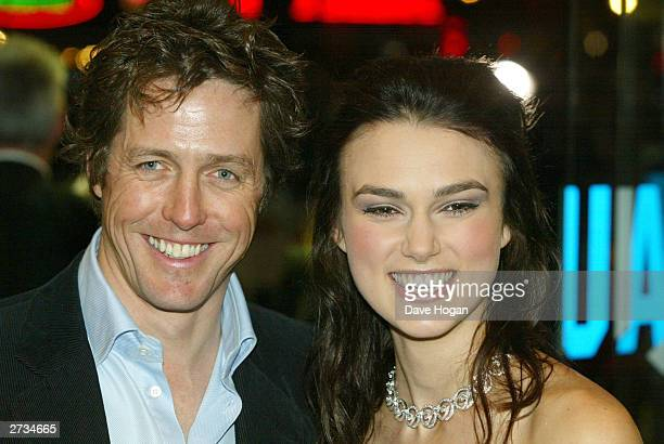 Actors Keira Knightley and Hugh Grant attend the UK charity film premiere of 'Love Actually' at The Odeon Leicester Square on November 16 2003 in...