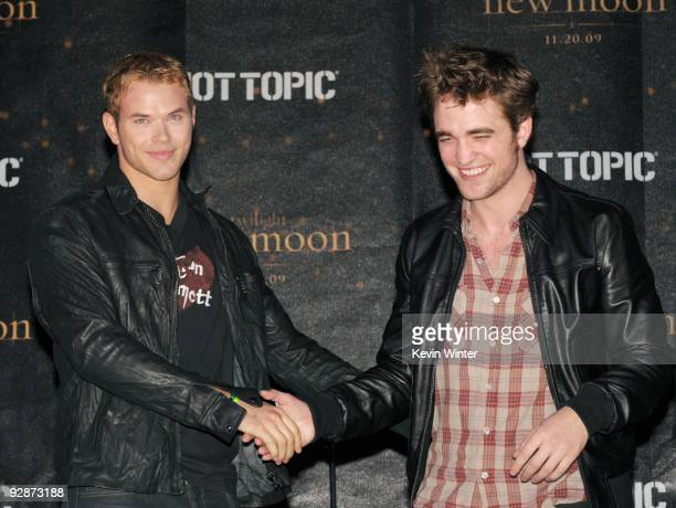 Actors Kellan Lutz and Robert Pattinson appear onstage at Summit's 'The Twilight Saga New Moon' Cast Tour at Hollywood and Highland on November 6...