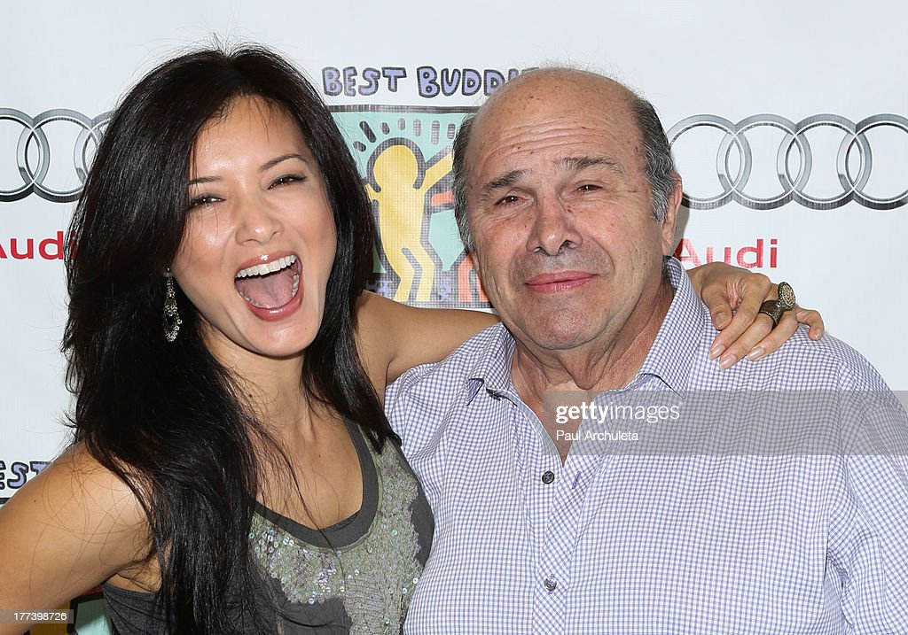Actors Kelly Hu (L) and Bobby Costanzo (R) attend the Best Buddies celebrity poker charity event at Audi Beverly Hills on August 22, 2013 in Beverly Hills, California.