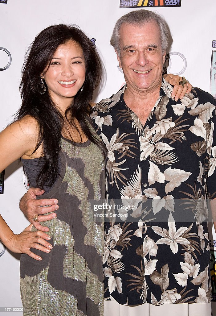 Actors <a gi-track='captionPersonalityLinkClicked' href=/galleries/search?phrase=Kelly+Hu&family=editorial&specificpeople=202918 ng-click='$event.stopPropagation()'>Kelly Hu</a> and Tom Hallick attend the Best Buddies poker event at Audi Beverly Hills on August 22, 2013 in Beverly Hills, California.