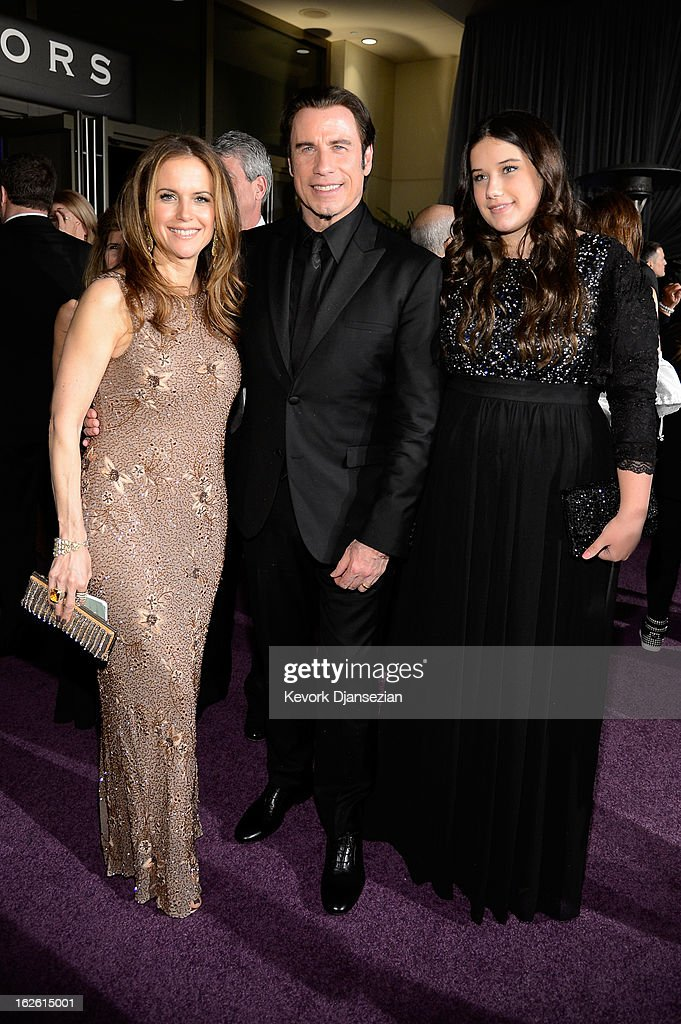 Actors Kelly Preston and John Travolta and daughter Ella Bleu Travolta attend the Oscars Governors Ball at Hollywood & Highland Center on February 24, 2013 in Hollywood, California.