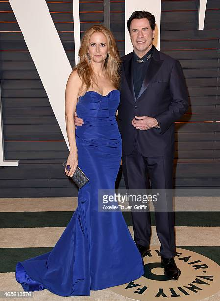 Actors Kelly Preston and John Travolta arrive at the 2015 Vanity Fair Oscar Party Hosted By Graydon Carter at Wallis Annenberg Center for the...