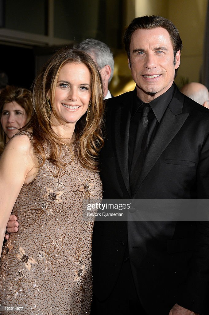 Actors Kelly Preston and John Travolta attend the Oscars Governors Ball at Hollywood & Highland Center on February 24, 2013 in Hollywood, California.
