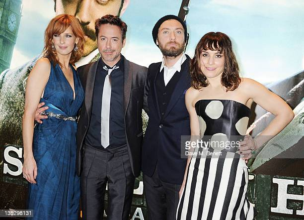 Actors Kelly Reilly Robert Downey Jr Jude Law and Noomi Rapace arrive at the European Premiere of 'Sherlock Holmes A Game of Shadows' at Empire...
