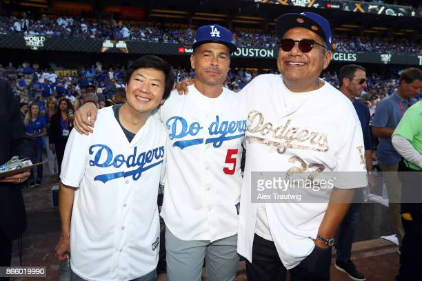 Actors Ken Jeong Rob Lowe and George Lopez pose for a photo on the field prior to Game 1 of the 2017 World Series between the Houston Astros and the...