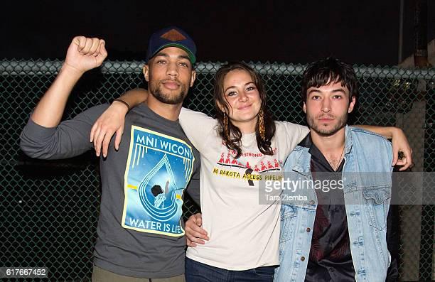 Actors Kendrick Sampson Shailene Woodley and Ezra Miller attend Climate Revolution at Levitt Pavilion MacArthur Park on October 23 2016 in Los...