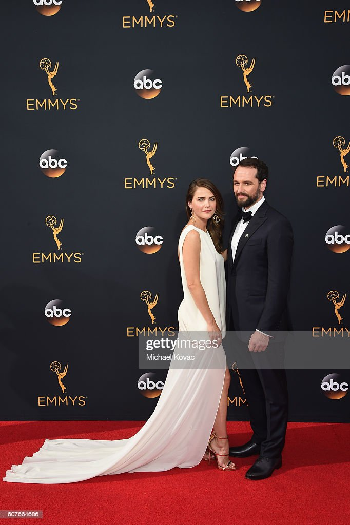 Actors Keri Russell (L) and Matthew Rhys attend 68th Annual Primetime Emmy Awards at Microsoft Theater on September 18, 2016 in Los Angeles, California.