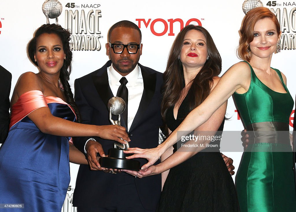 Actors Kerry Washington Columbus Short Katie Lowes and Darby Stanchfield winners of the Outstanding Drama Series award for 'Scandal' pose in the...