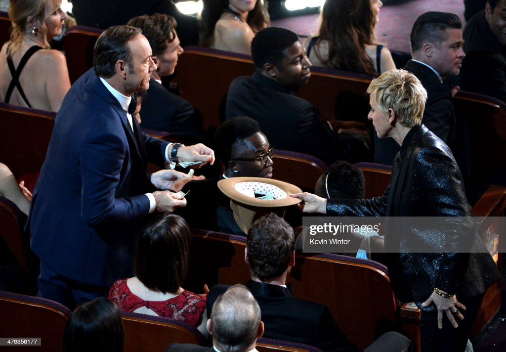 Actors <a gi-track='captionPersonalityLinkClicked' href=/galleries/search?phrase=Kevin+Spacey&family=editorial&specificpeople=202091 ng-click='$event.stopPropagation()'>Kevin Spacey</a>, actors <a gi-track='captionPersonalityLinkClicked' href=/galleries/search?phrase=Lupita+Nyong%27o&family=editorial&specificpeople=10961876 ng-click='$event.stopPropagation()'>Lupita Nyong'o</a>, Brad Pitt, and host <a gi-track='captionPersonalityLinkClicked' href=/galleries/search?phrase=Ellen+DeGeneres&family=editorial&specificpeople=171367 ng-click='$event.stopPropagation()'>Ellen DeGeneres</a> in the audience during the Oscars at the Dolby Theatre on March 2, 2014 in Hollywood, California.