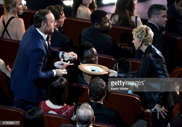 Actors Kevin Spacey actors Lupita Nyong'o Brad Pitt and host Ellen DeGeneres in the audience during the Oscars at the Dolby Theatre on March 2 2014...