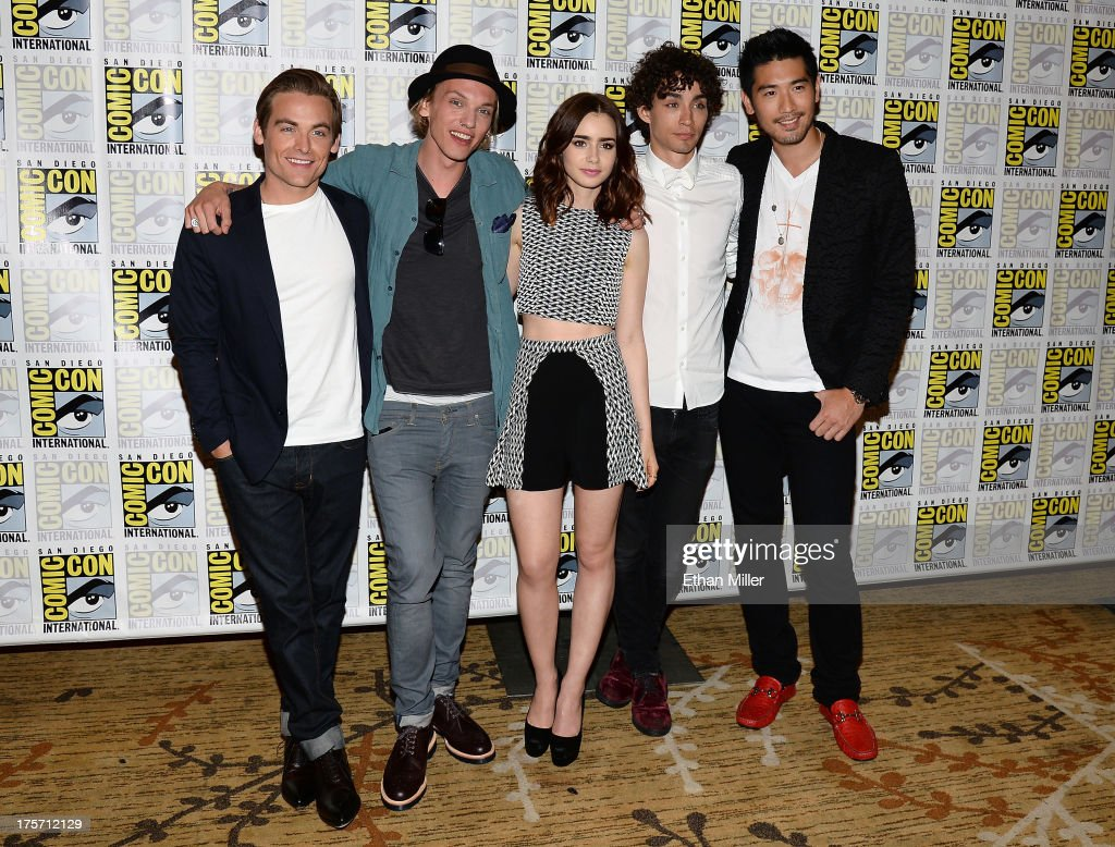 Actors Kevin Zegers and Jamie Campbell Bower, actress Lily Collins, and actors Robert Sheehan and Godfrey Gao attend 'The Mortal Instruments: City of Bones' press line at the Hilton San Diego Bayfront Hotel on July 19, 2013 in San Diego, California.