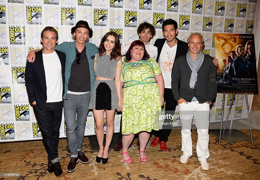 Actors Kevin Zegers, Jamie Campbell Bower and Lily Collins, author Cassandra Clare, actors Robert Sheehan and Godfrey Gao, and director Harald Zwart attend 'The Mortal Instruments: City of Bones' press line during Comic-Con International 2013 at the Hilton San Diego Bayfront Hotel on July 19, 2013 in San Diego, California.