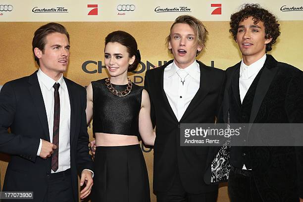 Actors Kevin Zegers Lily Collins Jamie Campbell Bower and Robert Sheehan arrive for the 'The Mortal Instruments City of Bones' Germany premiere at...